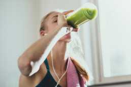 Person drinking a smoothie